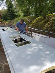 Aaran working on our boutique narrowboat