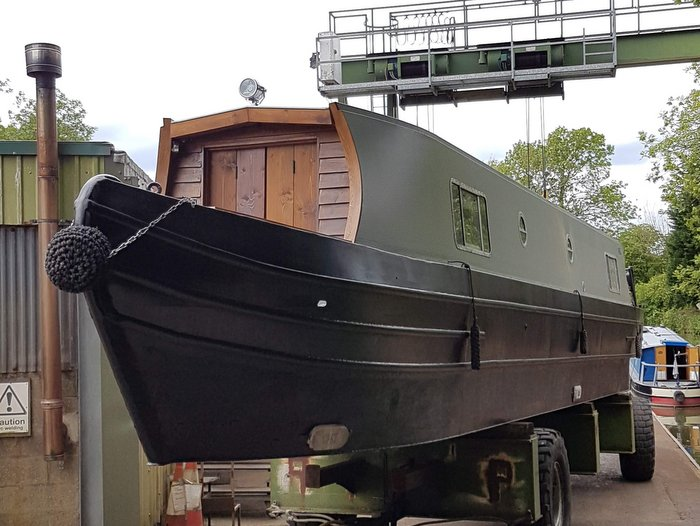 Boutique Narrowboat waits to go into water at Debdale
