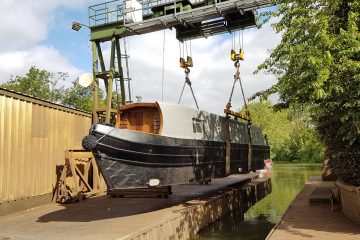 canal boat hire lowered into water