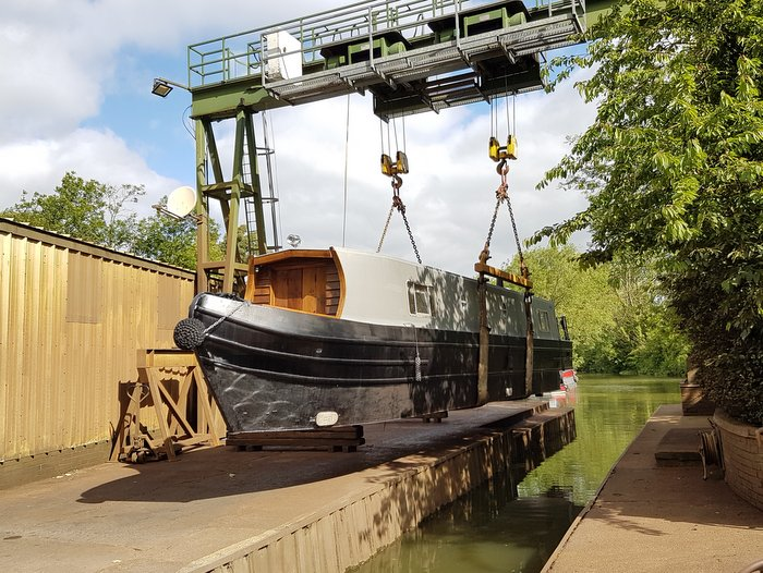 canal boat lifted into water