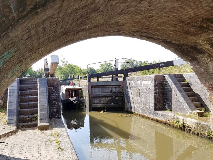 Boutique Narrowboat exiting a lock on the Grand Union Canal Leicester Line