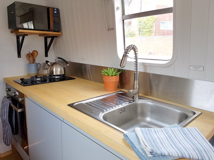 Boutique narrowboat Chalkhill Blue interior 1 kitchen