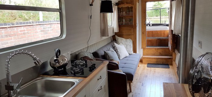 The lounge area in Lesley Ann Boutique narrowboat at union wharf Marina Market Harborough