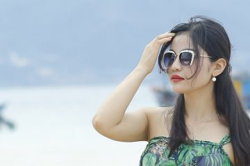 woman wearing sunglasses on a boating holiday