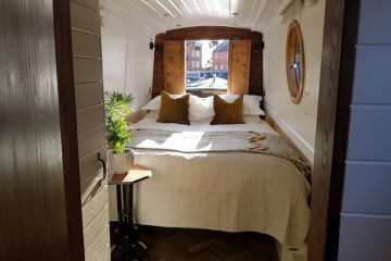 The king sized bed on boutique narrowboat at union wharf for narrowboat holidays 2022