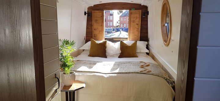 King sized bed on luxury canalboat for hire