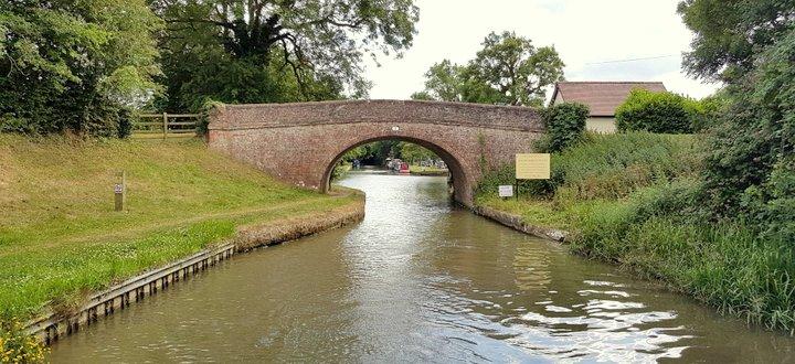 Canal boat going through bridge