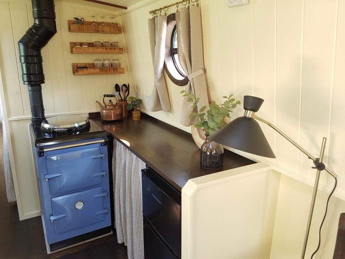 Boutique Narrowboat, Kathleen May, showing little fridge and Aga