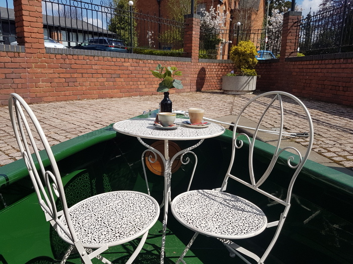 Decorative chairs on the front deck of Kathleen May canal boat
